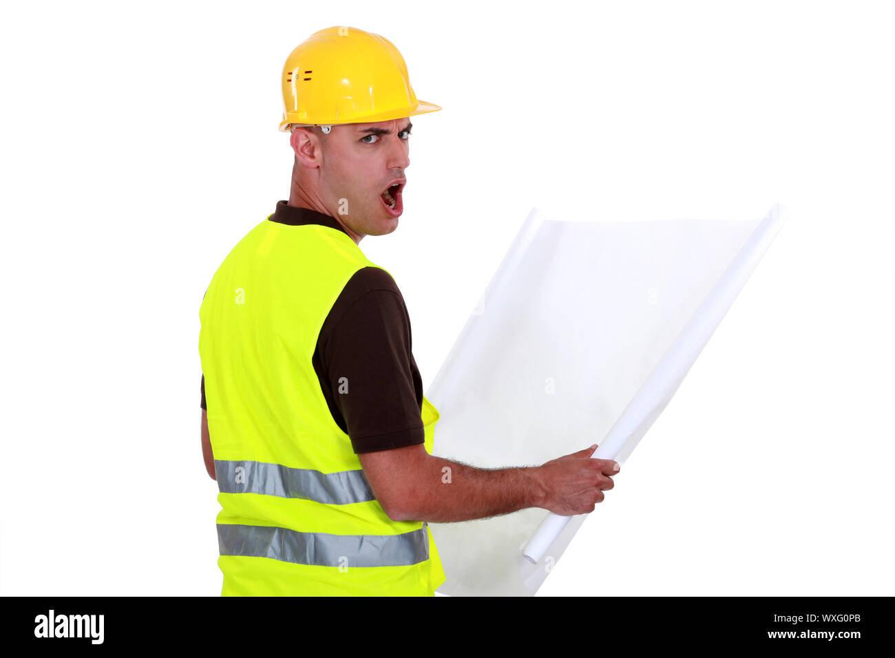 Worker open mouthed in disbelief Stock Photo