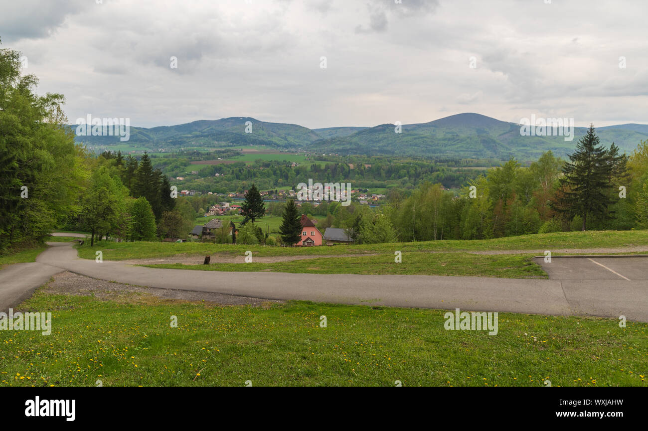 Hradek village with hills of Moravskoslezske Beskydy mountains on the background in Czech republic during springtime Stock Photo
