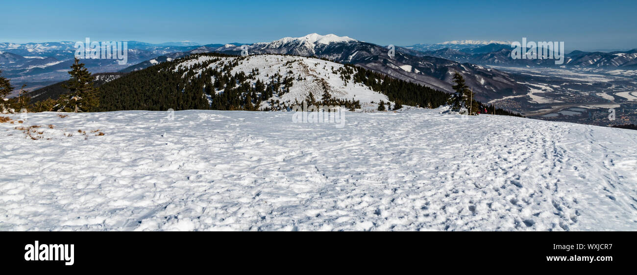 spectacular mountain panorama with many hills and peaks from Mincol hill in Mala Fatra mountains in Slovakia during winter day with clear sky Stock Photo