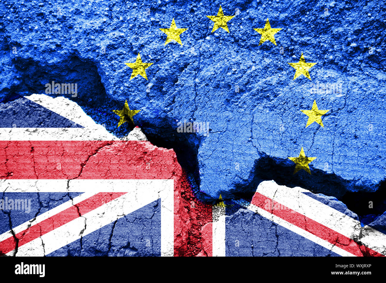 Brexit, Flags of the United Kingdom and the European Union on cracked background Stock Photo