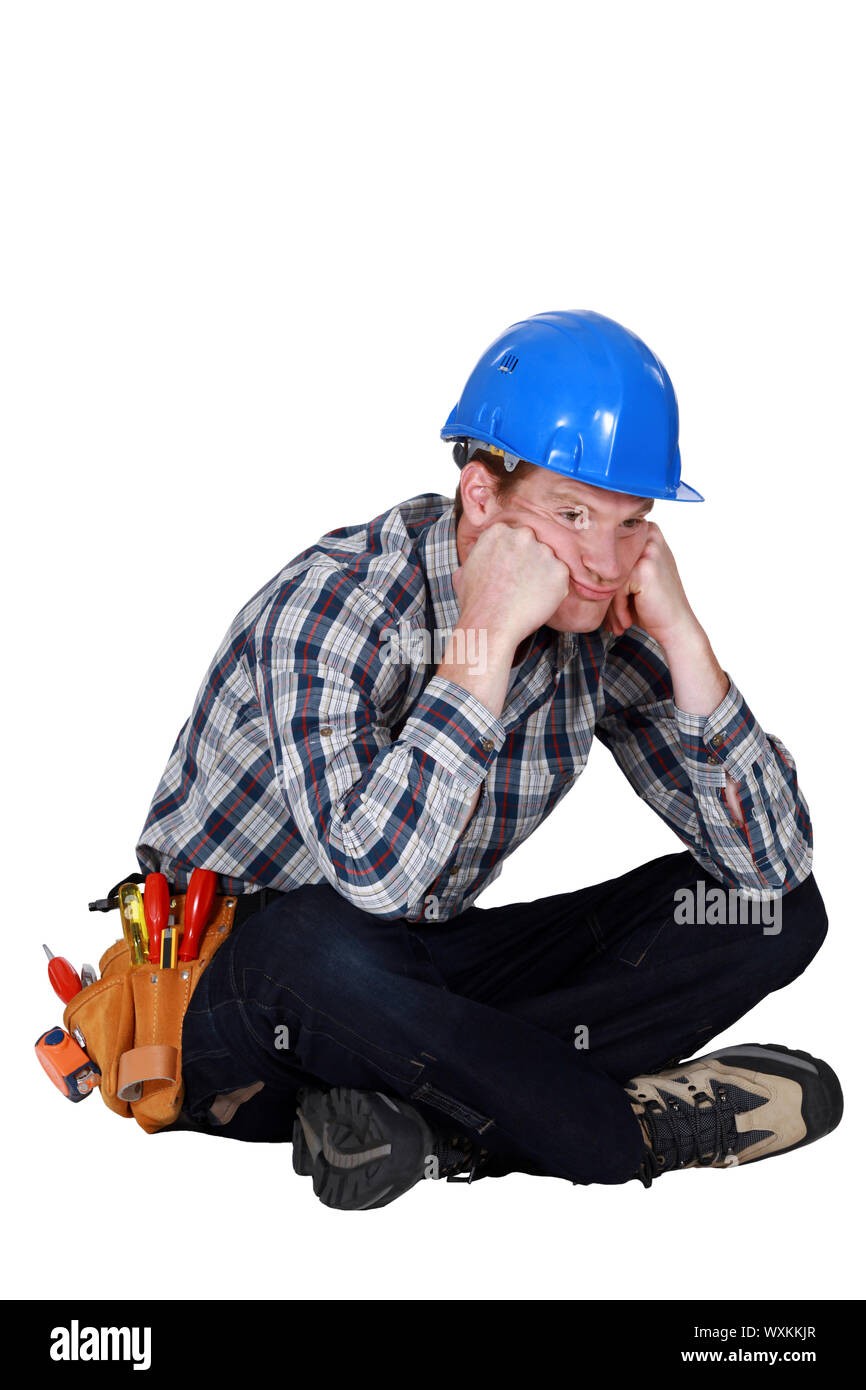A fed-up and bored tradesman Stock Photo