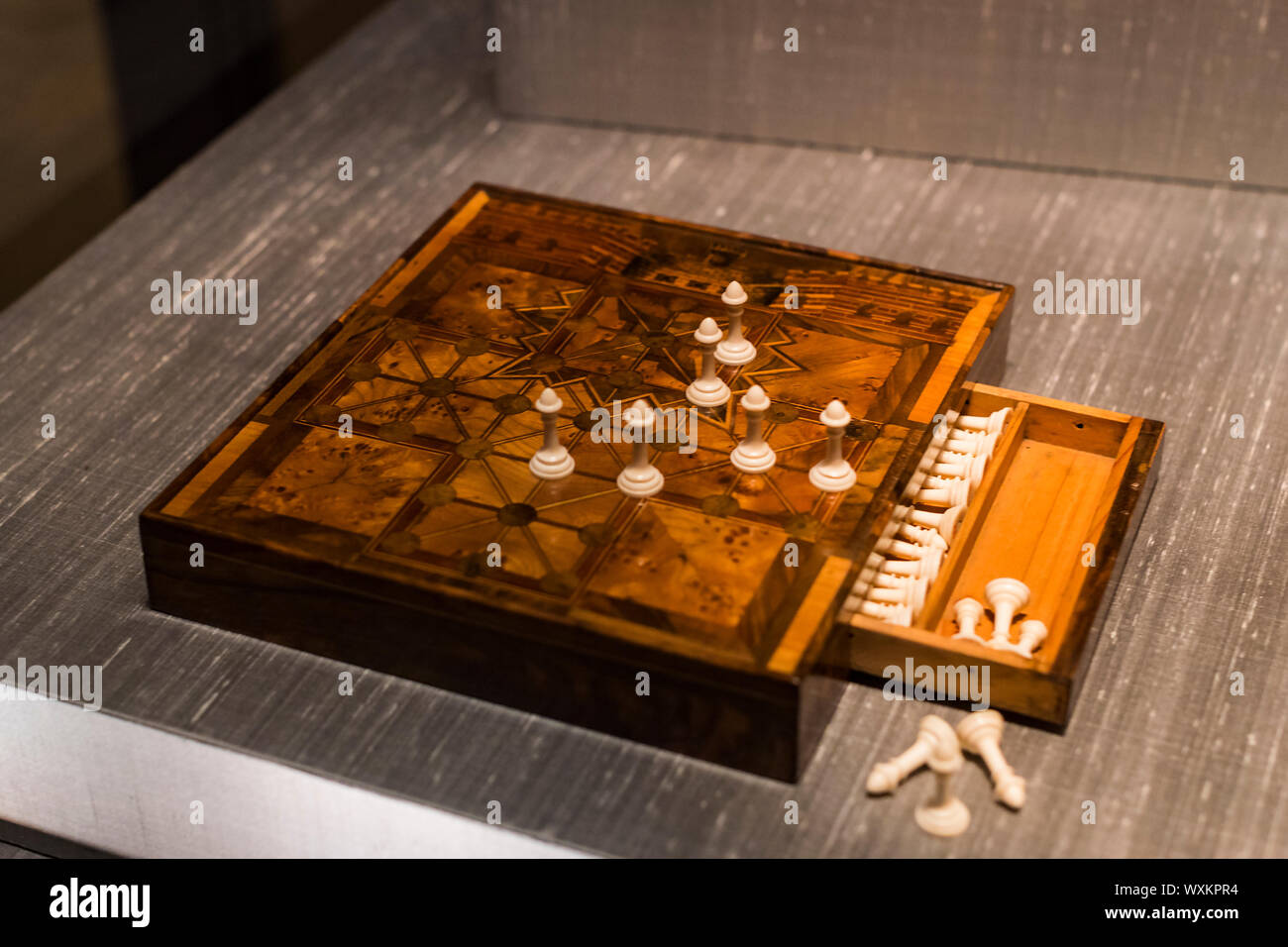 MUNICH, GERMANY - NOVEMBER 27, 2018 : The Represents an exposition of the history of the development of board games chess backgammon poker in the Bava - Stock Photo