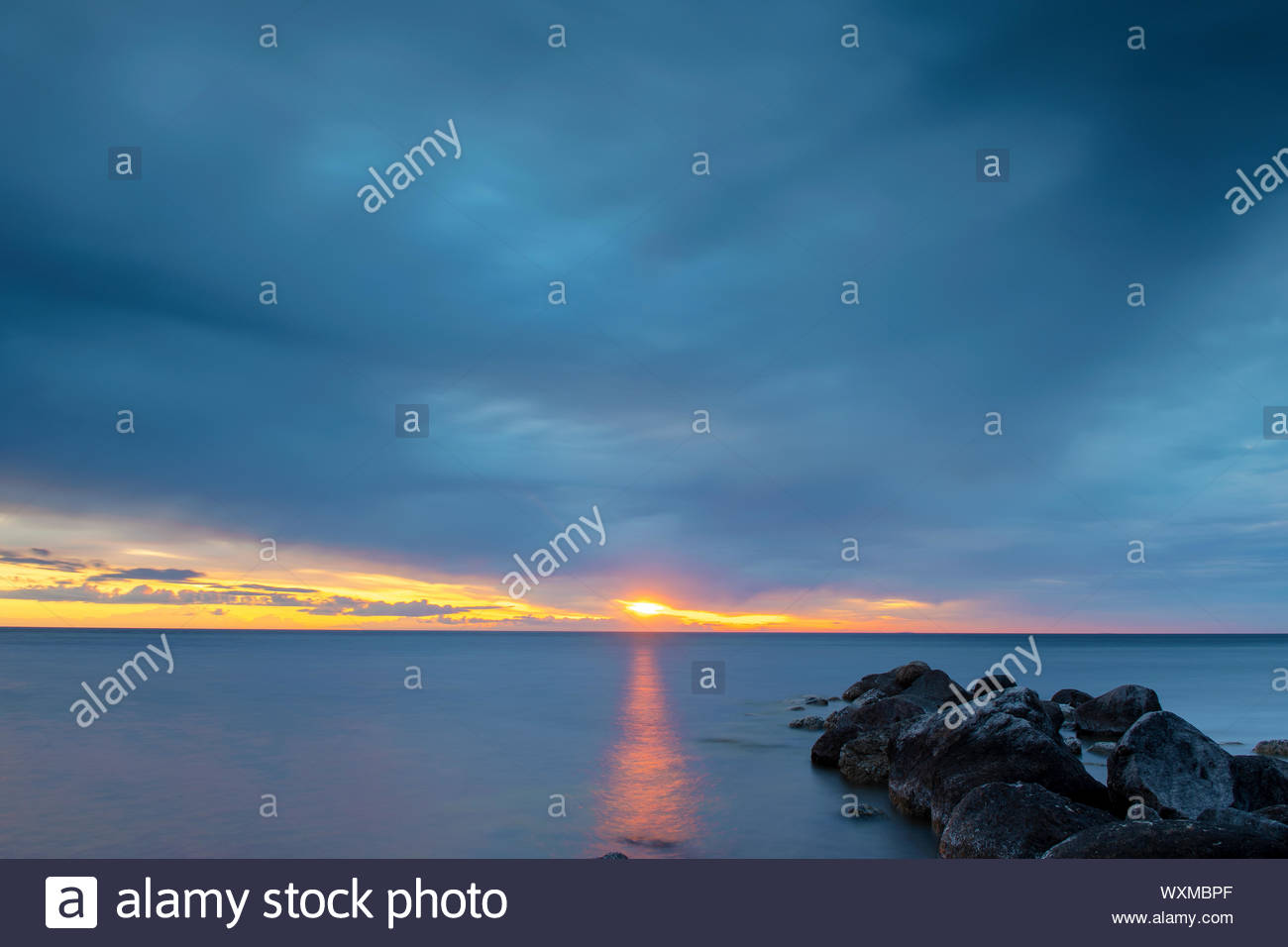 Calm Peaceful Ocean After Sunset Stock Photo