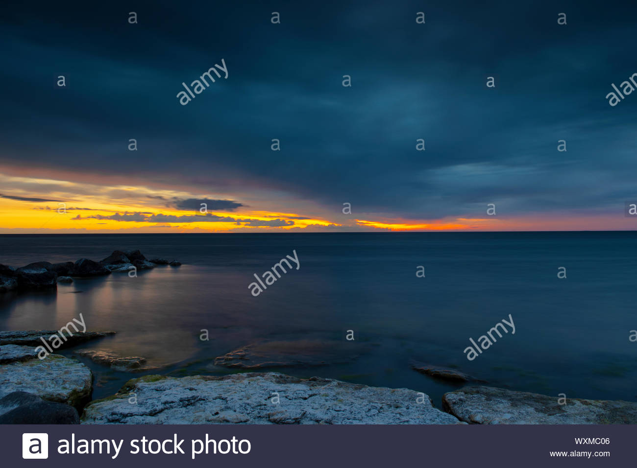 Calm Peaceful Ocean After Sunset Stock Photo