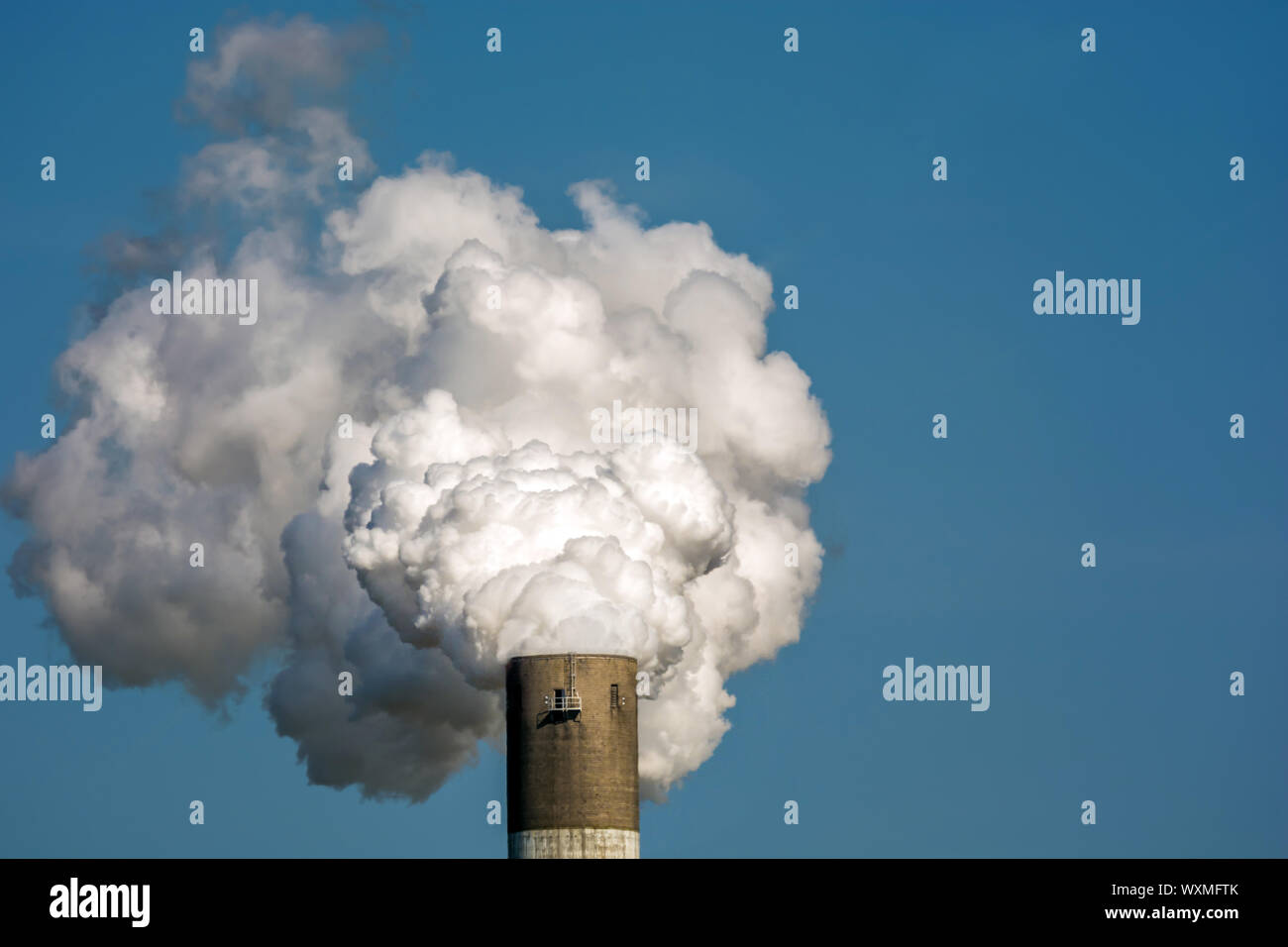 Exhaust gases and pollutants by the industry using the example of a smoky chimney Stock Photo