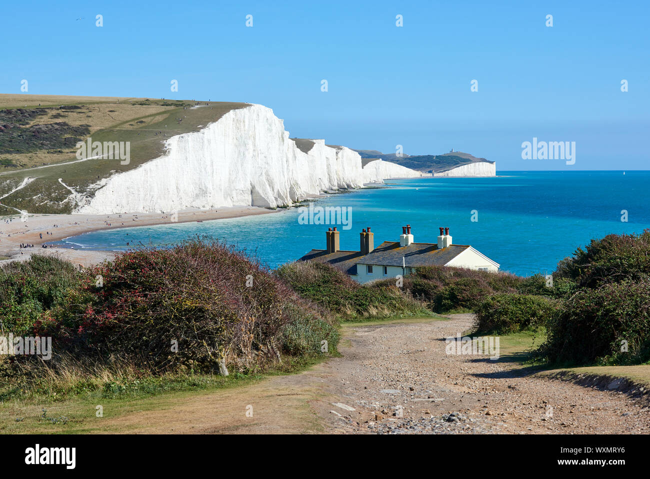 The Seven Sisters cliffs from Seaford Head above Cuckmere Haven, near Eastbourne, on the East Sussex coast, looking East, with coastguard cottages Stock Photo