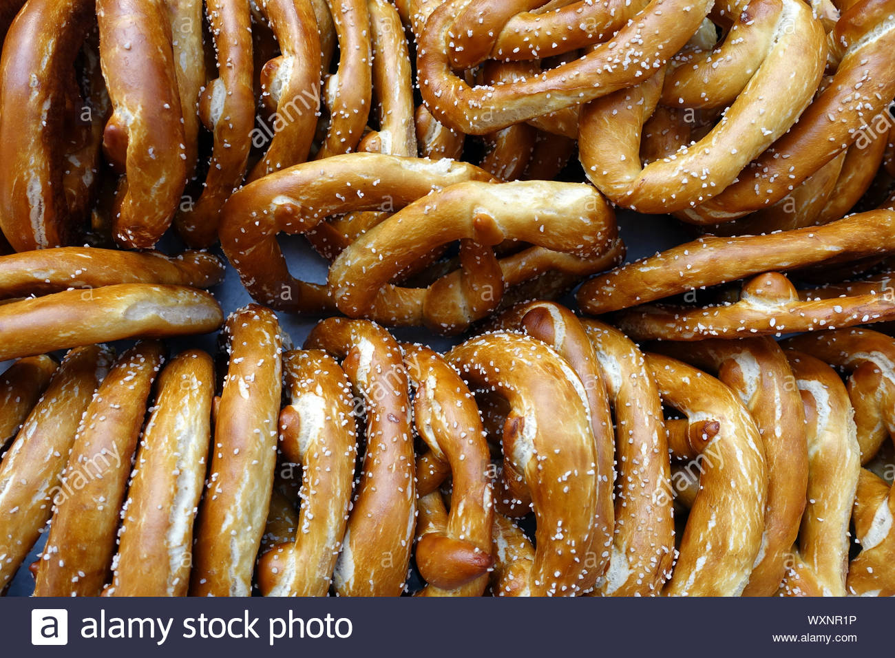 A Tray of Homemade Soft Pretzels for Sale Stock Photo