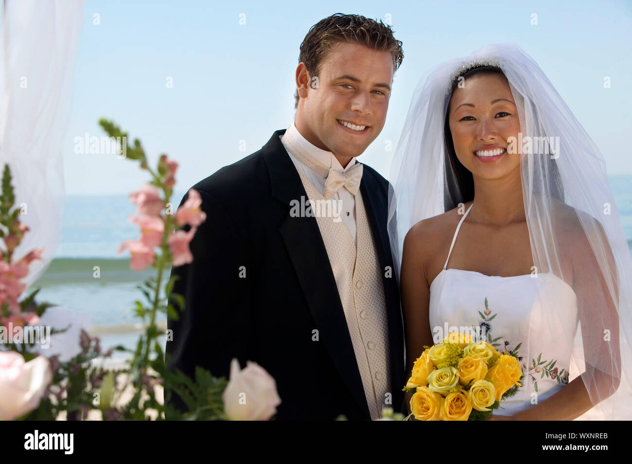 Bride and Groom on Beach Stock Photo