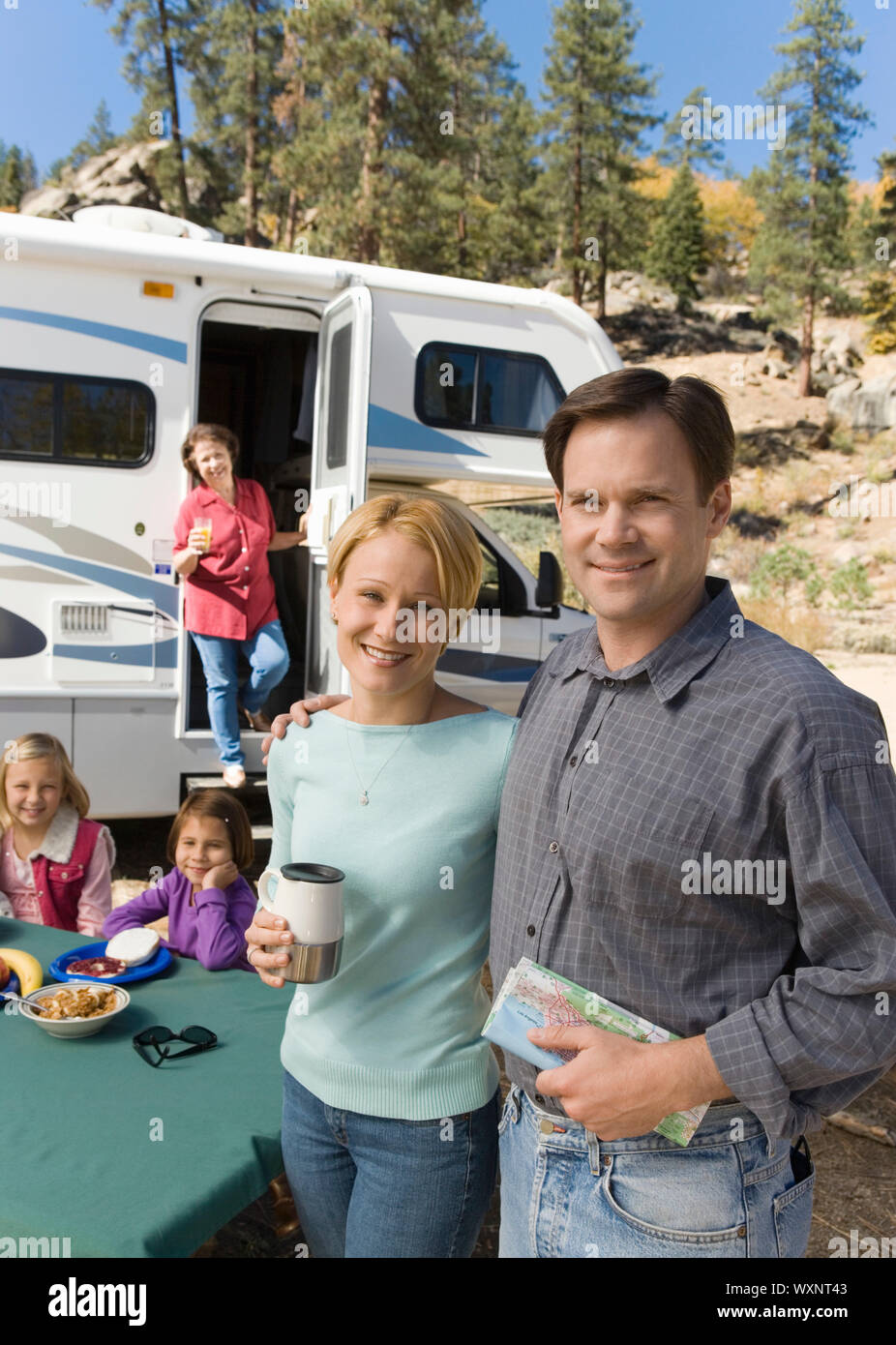 Couple on Vacation with Family Stock Photo