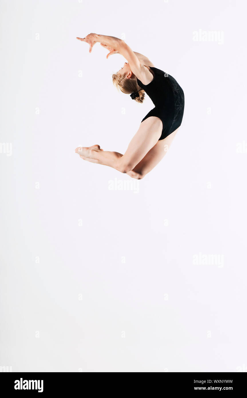 Young Gymnast Mid-air Stock Photo