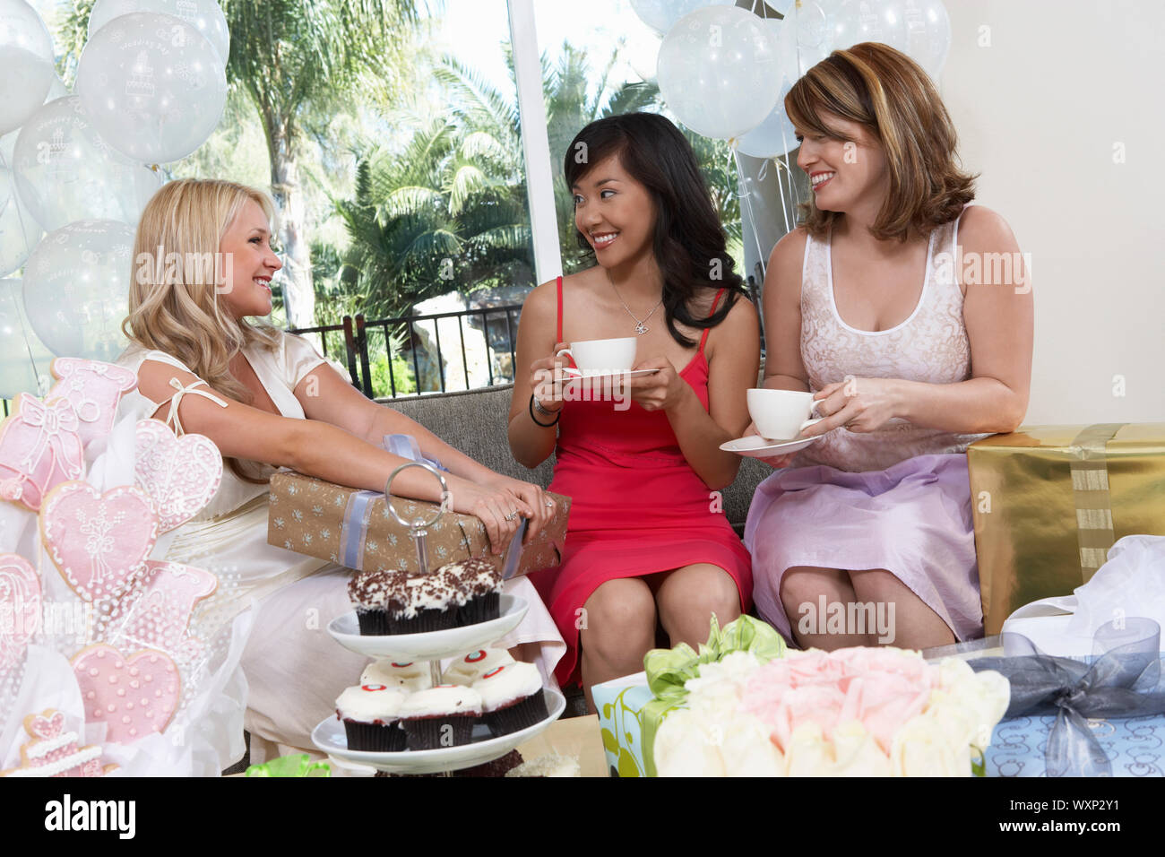 Friends Giving Gifts at Bridal Shower Stock Photo