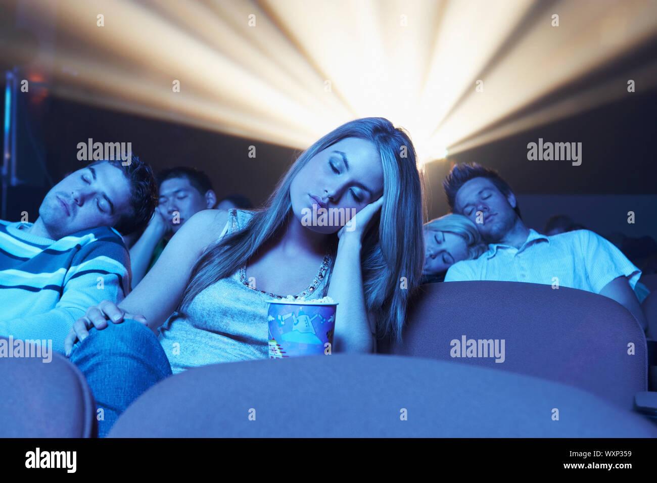 People Asleep in Movie Theater Stock Photo