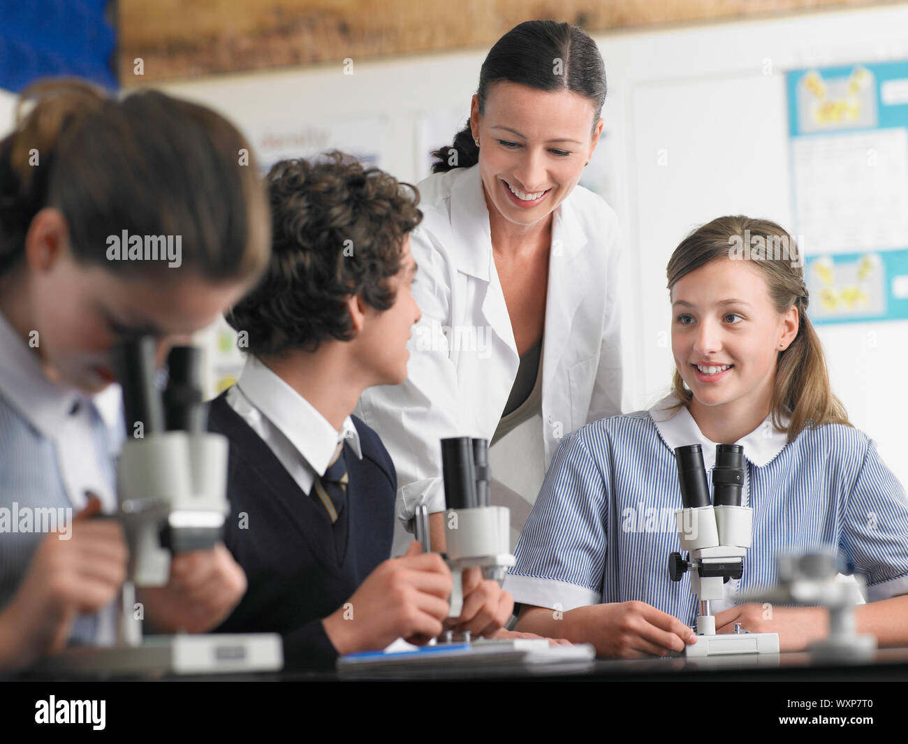 High School Students With Teacher in Chemistry Class Stock Photo