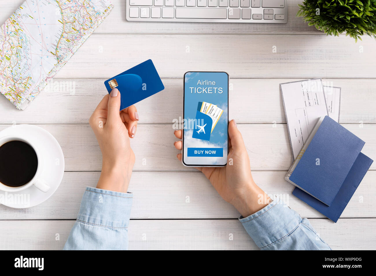 Woman buying plane tickets in Internet via application on smartphone Stock Photo