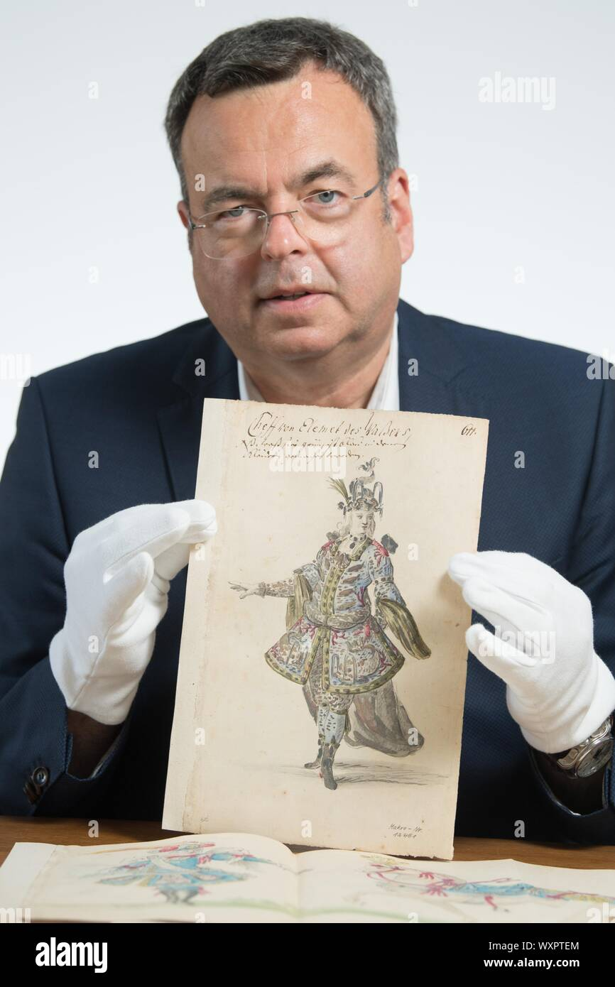 Dresden, Germany. 19th Aug, 2019. Peter Wiegand, Head of Department of the Saxon State Archives, holds a costume sketch from 1719. On 25 August 2019 Dresden celebrates the Prince's Wedding of Friedrich August II on the occasion of its 300th anniversary. Credit: Sebastian Kahnert/dpa-Zentralbild/dpa/Alamy Live News Stock Photo