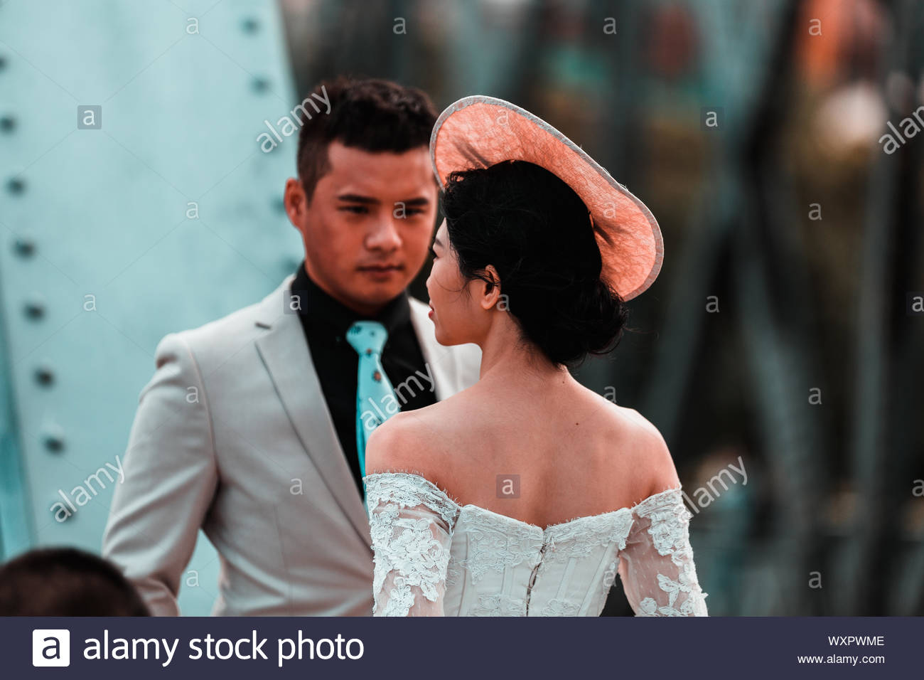 wedding in shanghai china at the bund you will see many brides and grooms in traditional wedding suite on the promenade celebrating a photoshoot WXPWME