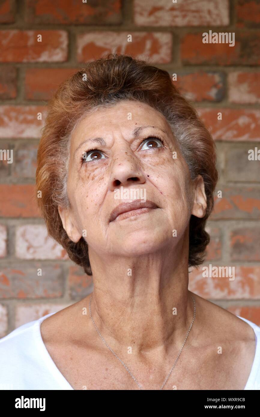 Portrait Of An Older Mixed Race Woman Looking Up With Stunning Brown Eyes Stock Photo Alamy
