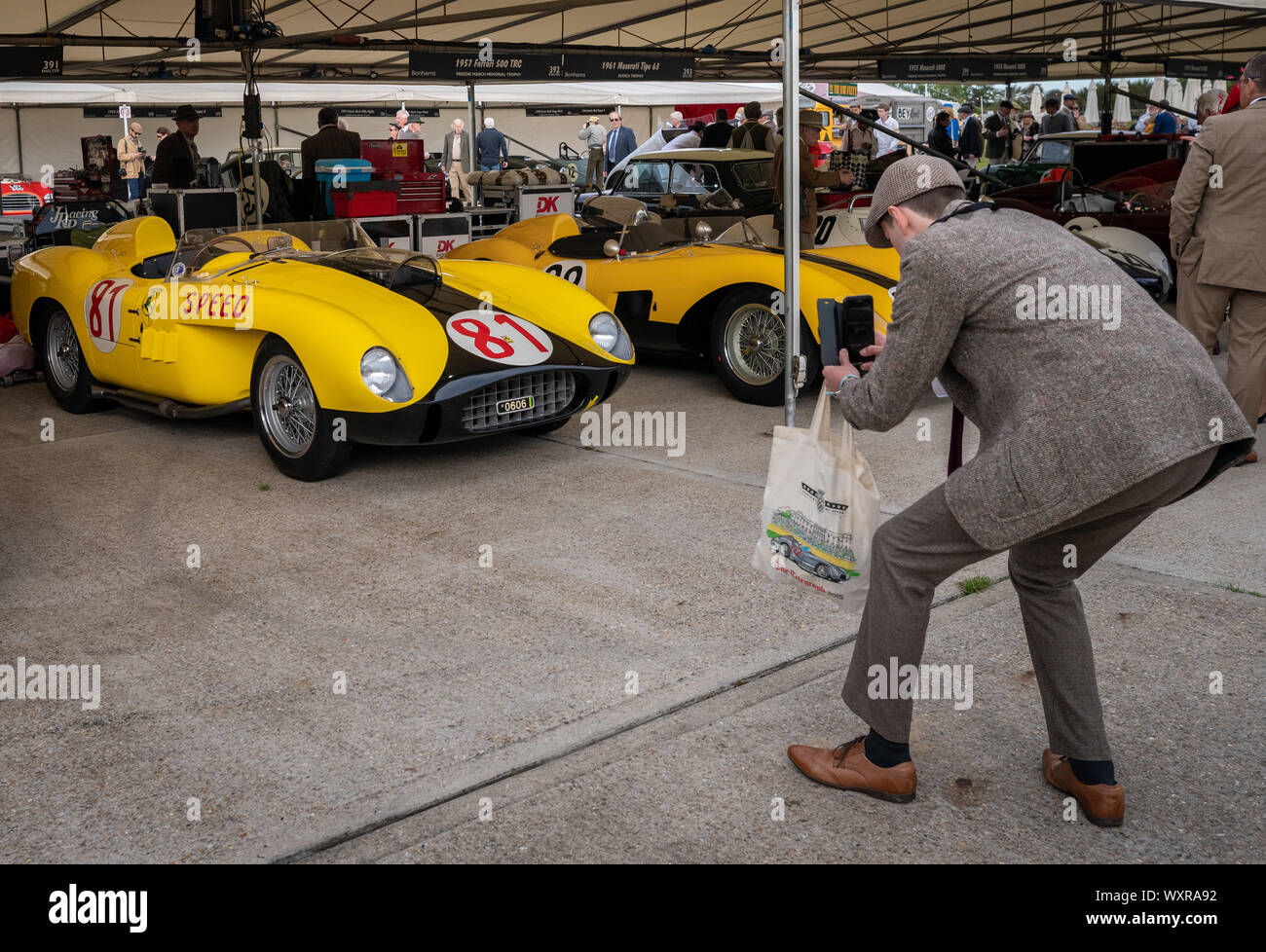 Vintage cars from the 1930's to the 1950's in the paddock during the Goodwood Revival car festival, UK. Stock Photo