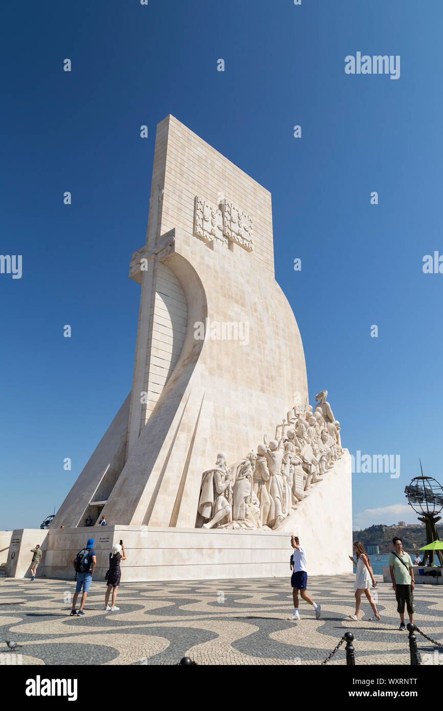 Tourists at the Padrao dos Descobrimentos (Monument to the Discoveries) monument on the edge of the Tagus River in Belem district in Lisbon, Portugal. Stock Photo
