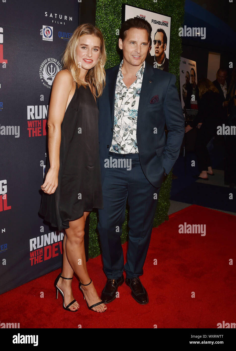 """BEVERLY HILLS, CA - SEPTEMBER 16: Lily Anne Harrison (L) and Peter Facinelli attend the Premiere Of Quiver Distribution's """"Running With The Devil"""" at Writers Guild Theater on September 16, 2019 in Beverly Hills, California. Stock Photo"""