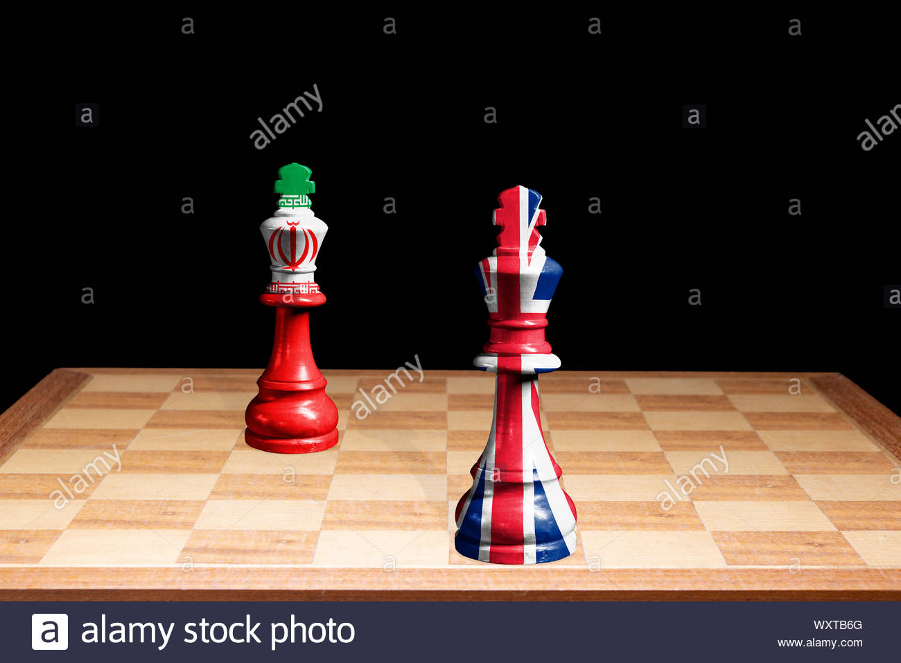 Conceptual image of United Kingdom (Union Jack) and the Islamic Republic of Iran flags as two chess pieces facing each other, England, UK Stock Photo