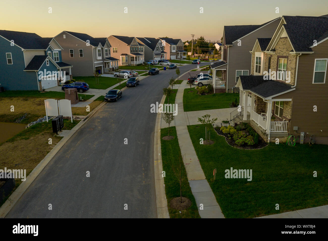 Aerial view of typical American new construction neighborhood street in Maryland for the upper middle class, single family homes USA real estate Stock Photo
