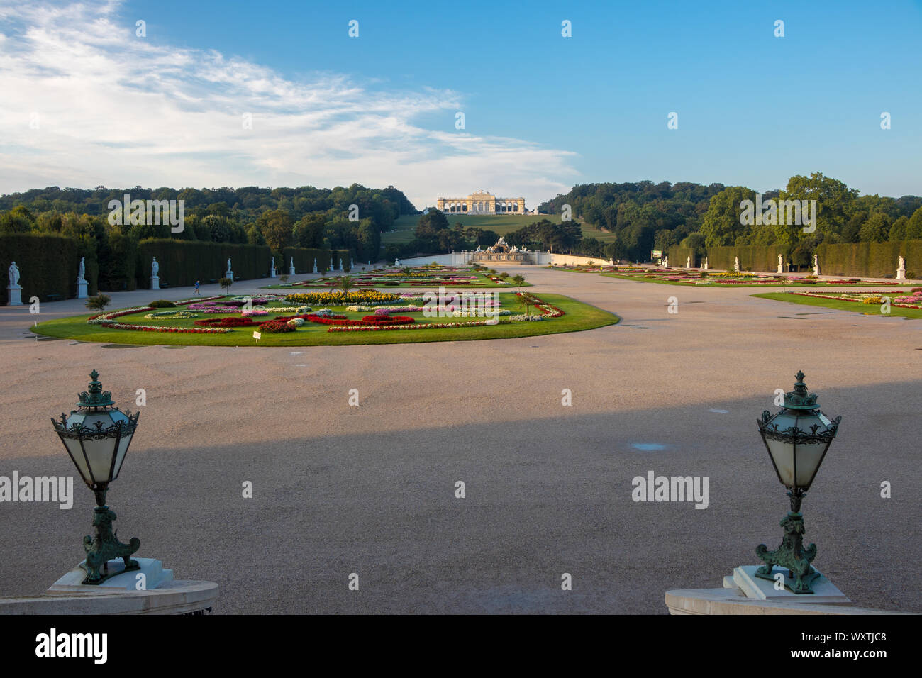 Vienna, Austria - September 3, 2019: Schönbrunn Palace and garden with colorful flowers. The photo was taken early in the morning. Warm colors thanks Stock Photo