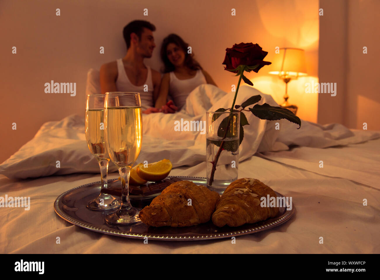 Couple In Love Having Romantic Supper In Bedroom Stock Photo Alamy