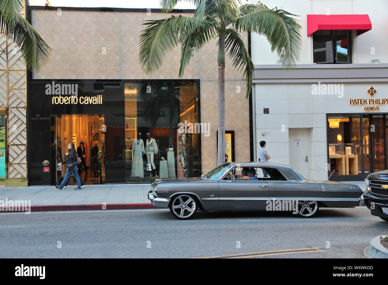 LOS ANGELES, USA - APRIL 5, 2014: People walk in Beverly Hills, Los Angeles. Beverly Hills is a district of upscale shopping and rich celebrities. Stock Photo