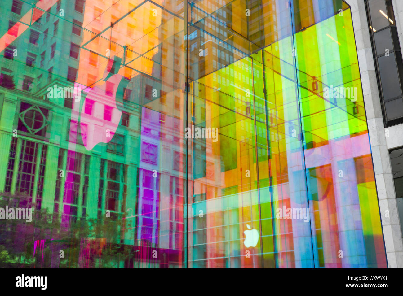The iconic Apple store glass cube is in a temporary iridescent wrap, Fifth Avenue, NYC, USA Stock Photo
