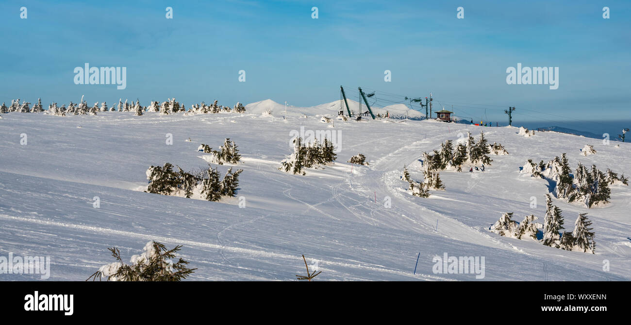Martinske hole (Martinky) ski resort above Martin town in Slovakia during amazing winter day with blue sky Stock Photo