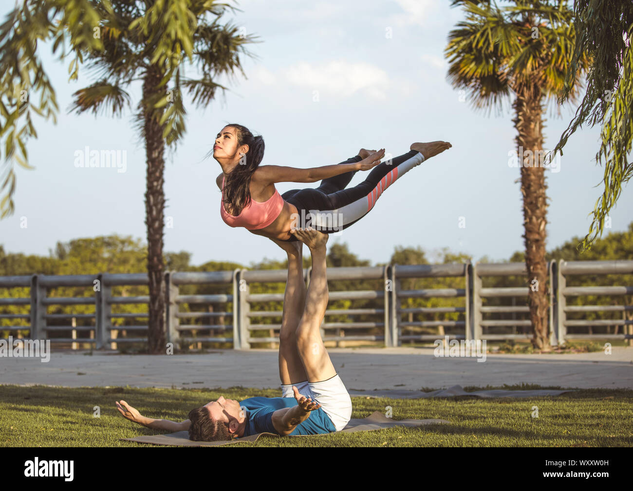 Latin Woman And Caucasian Man Do Yoga Exercises In A Park In Madrid Balance And Concentration In Couple Stock Photo Alamy