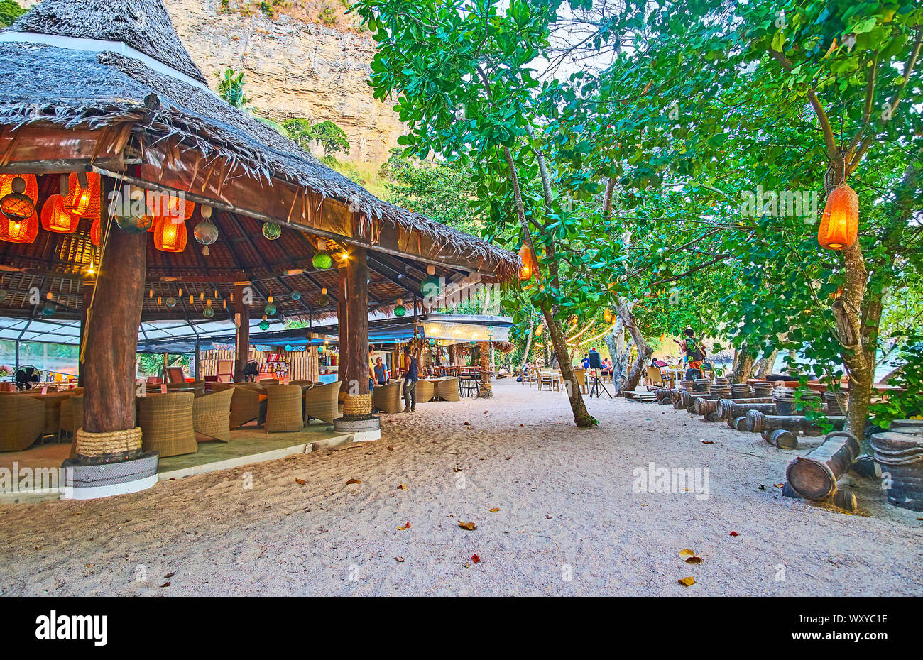 AO NANG, THAILAND - APRIL 25, 2019: The beach bar in wooden hut is decorated with many lanterns, making it cozy and romantic, on April 25 in Ao Nang Stock Photo