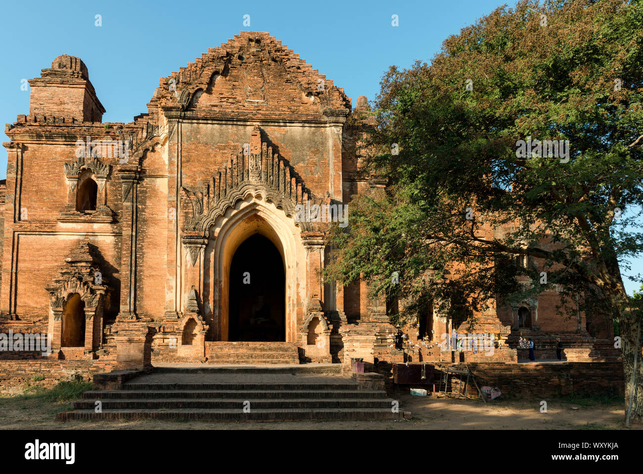 Wide angle picture of the entrance of the huge architecture Dhammayan Gyi Temple, a landmark of Bagan, Myanmar Stock Photo