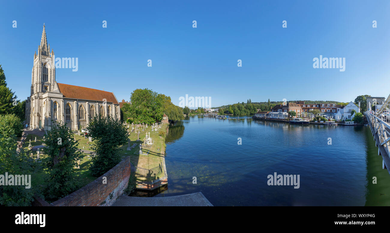 View east in the town of Marlow in the Wycombe district of Buckinghamshire, southeast England of All Saints Church and the River Thames Stock Photo