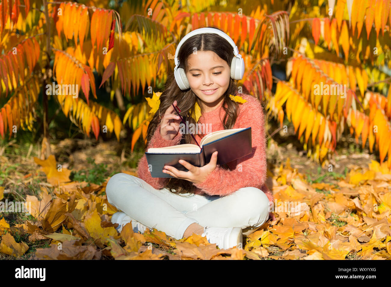 Girl Read Book On Autumn Day Little Child Enjoy Learning In