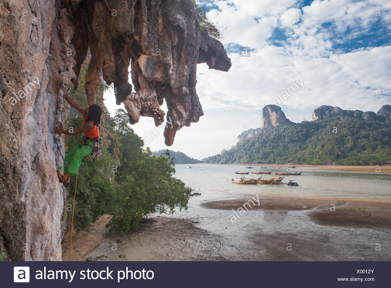 A climber on the 1,2,3, wall in Railay, Thailand. - Stock Image