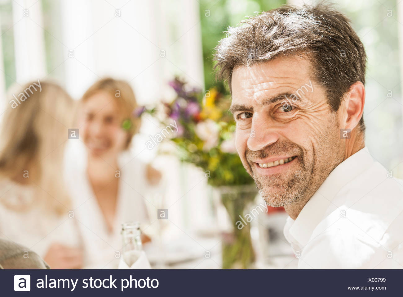 Portrait of mature man at family birthday party - Stock Image