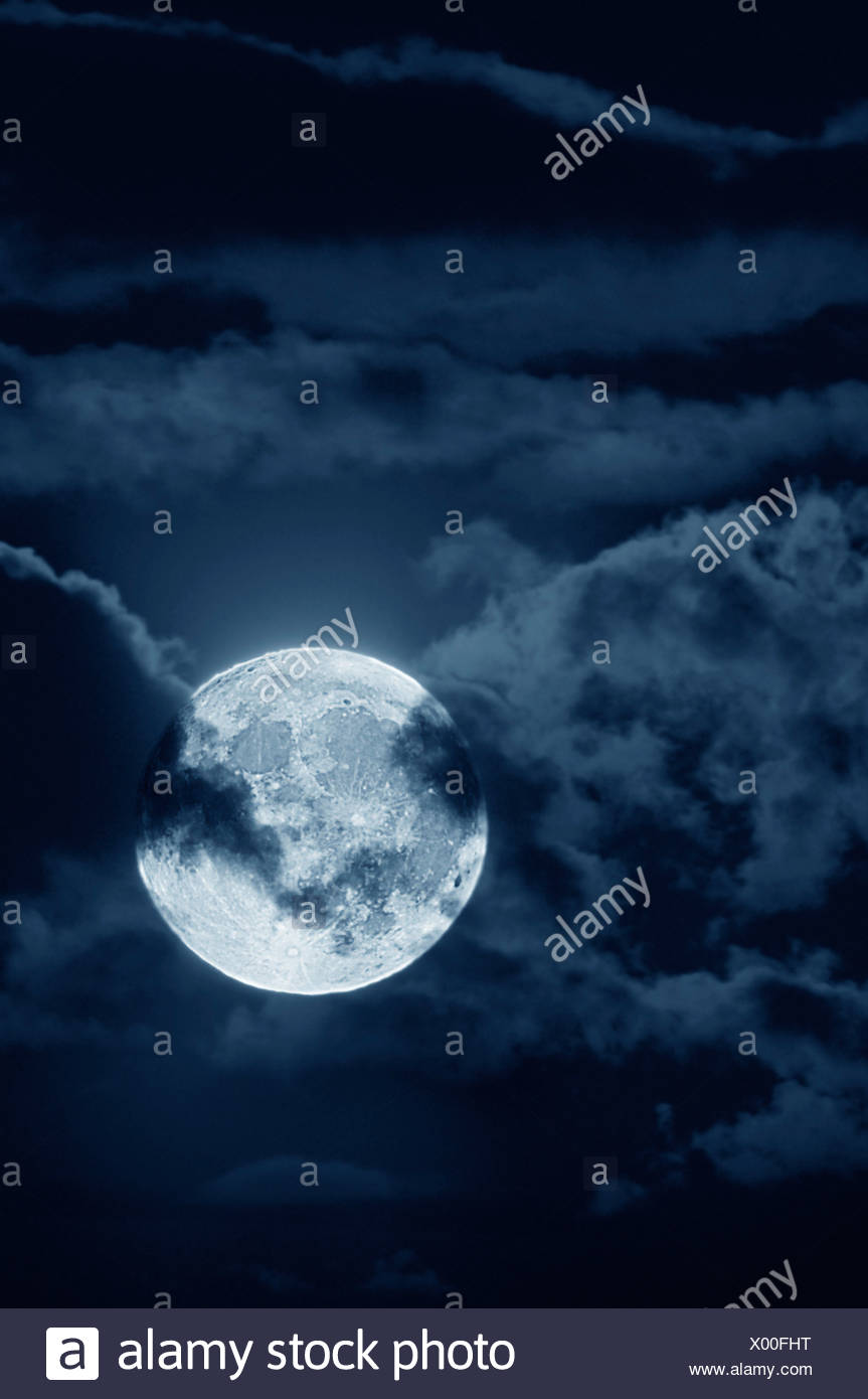Full moon with clouds at night - Stock Image