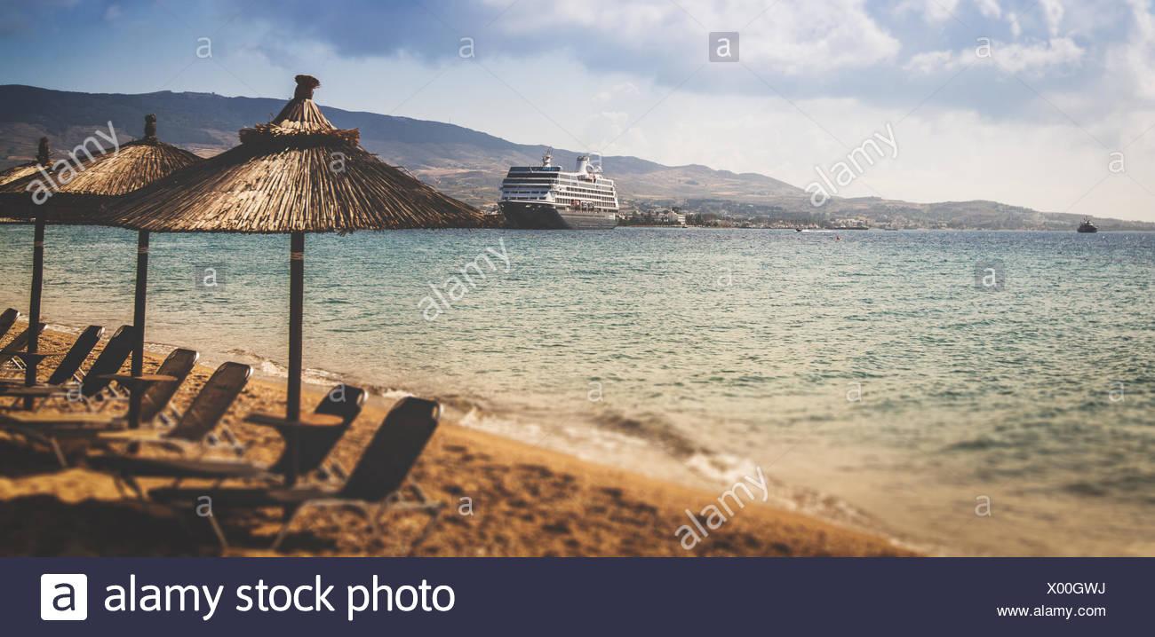Sun loungers and umbrellas on the beach, Kos, Greece Stock Photo