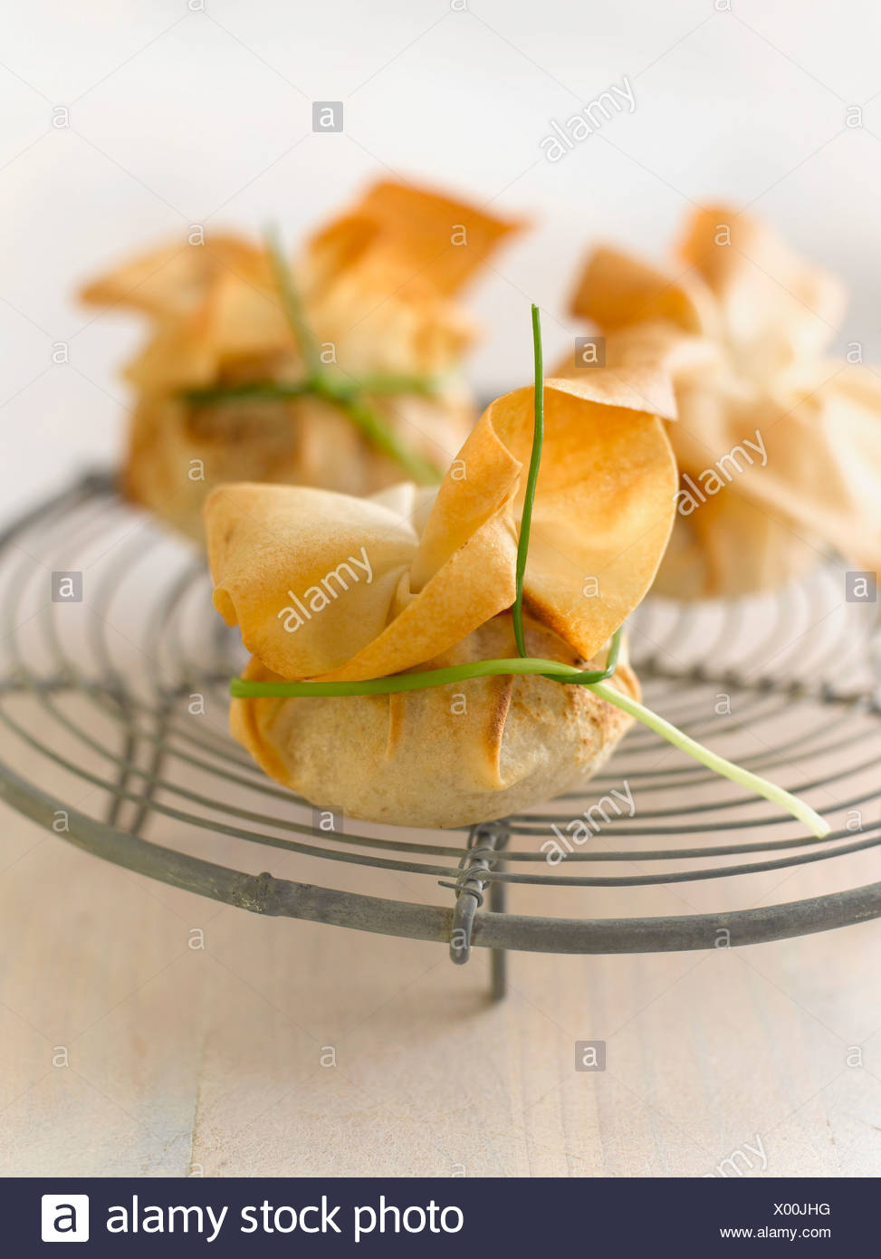 Stuffed dim sum bag on cooling rack - Stock Image