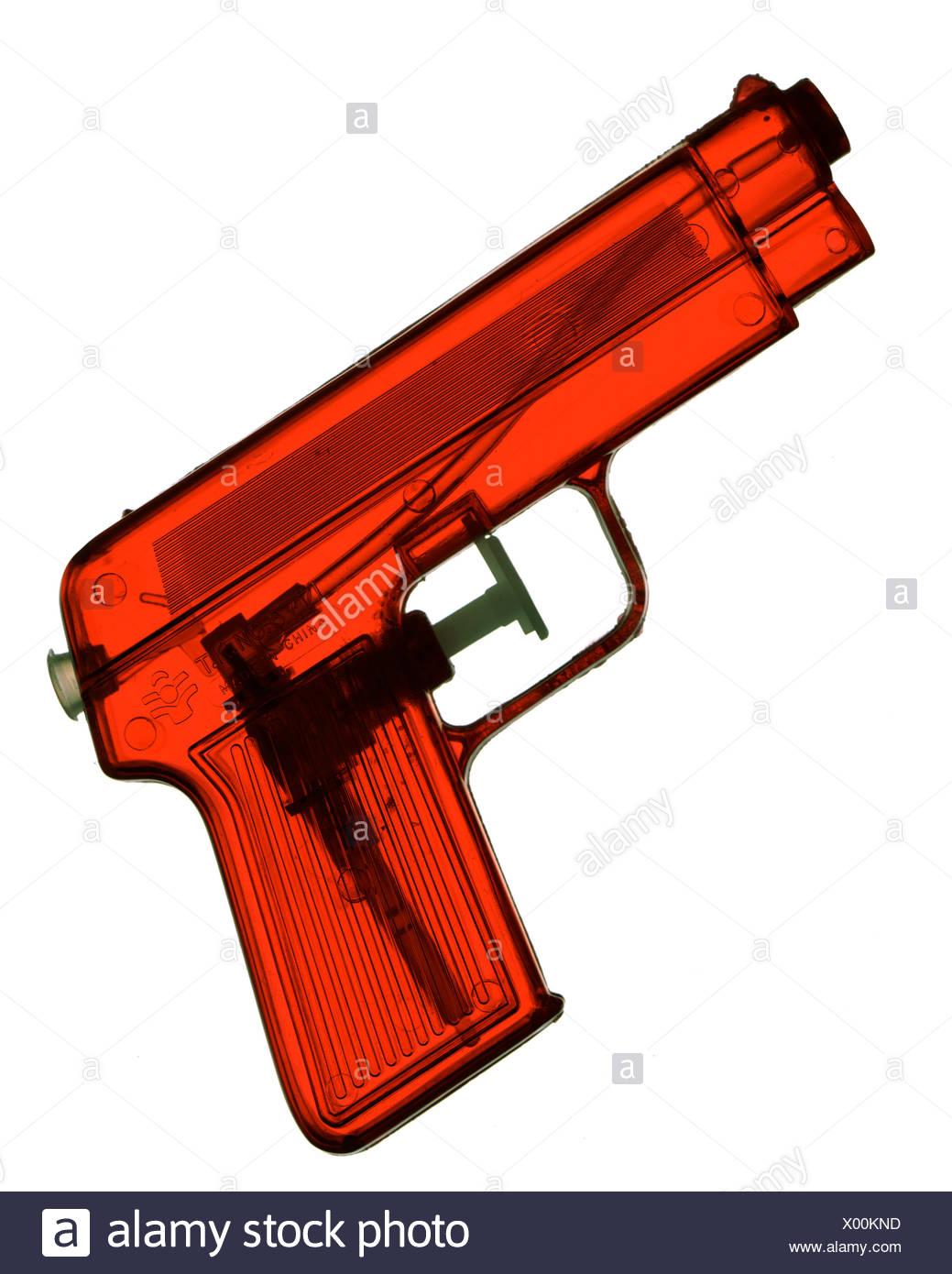 Red, transparent water gun - Stock Image