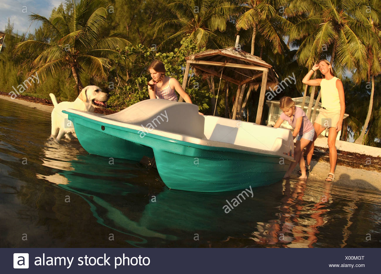Sisters ready a new paddleboat, Florida. Stock Photo