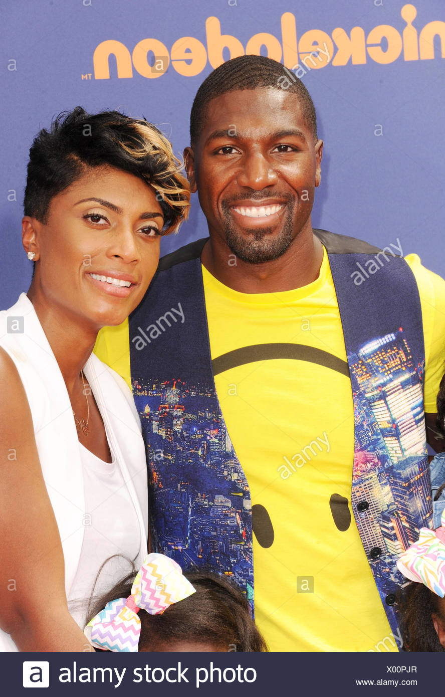 NFL player Greg Jennings and wife arrive at the Nickelodeon Kids' Choice Sports Awards 2015 at UCLA's Pauley Pavilion on July 16, 2015 in Westwood, California., Additional-Rights-Clearances-NA - Stock Image