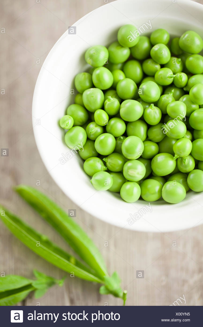 Shelled Peas in Bowl - Stock Image