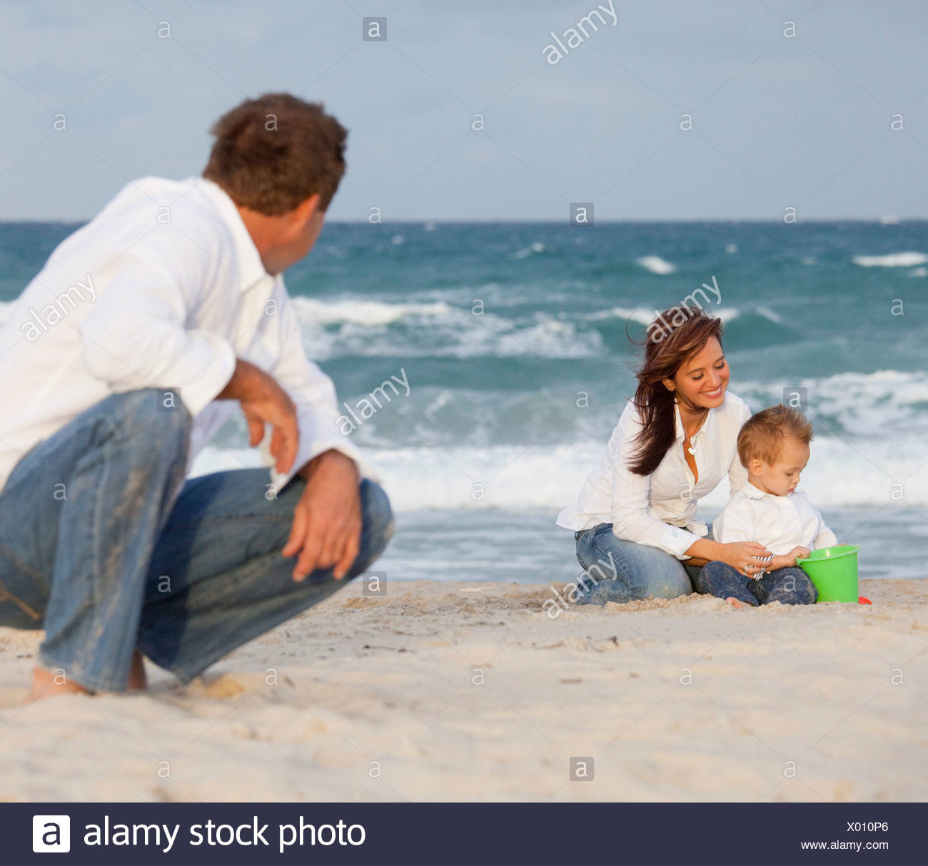 Fort Lauderdale, Florida, United States Of America; A Man Watching His Family On The Beach - Stock Image