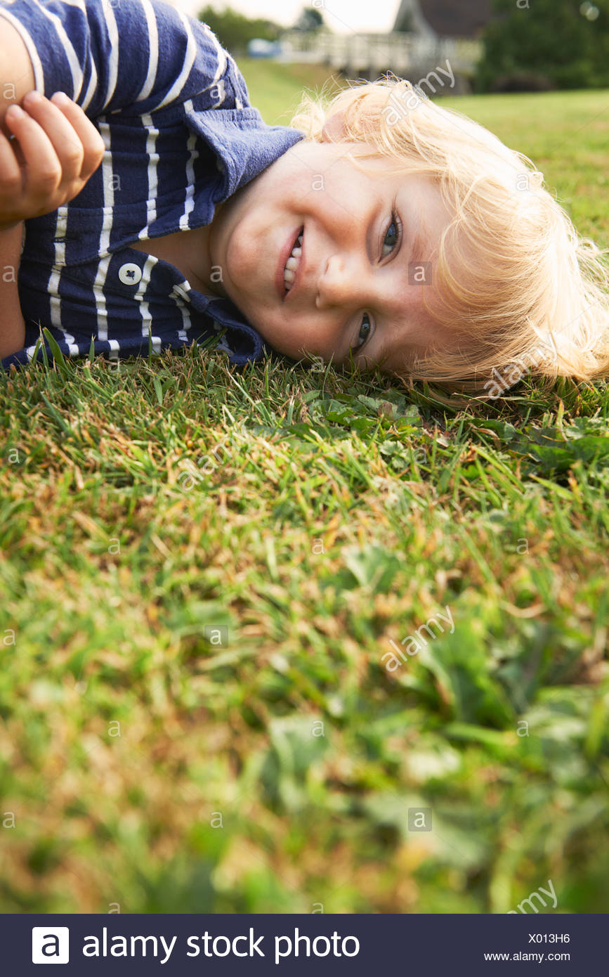 Young boy playing in garden Stock Photo