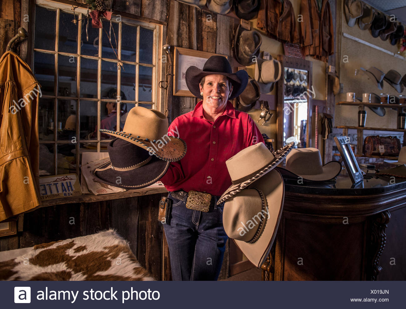 A hat maker shows off her famous creations. - Stock Image