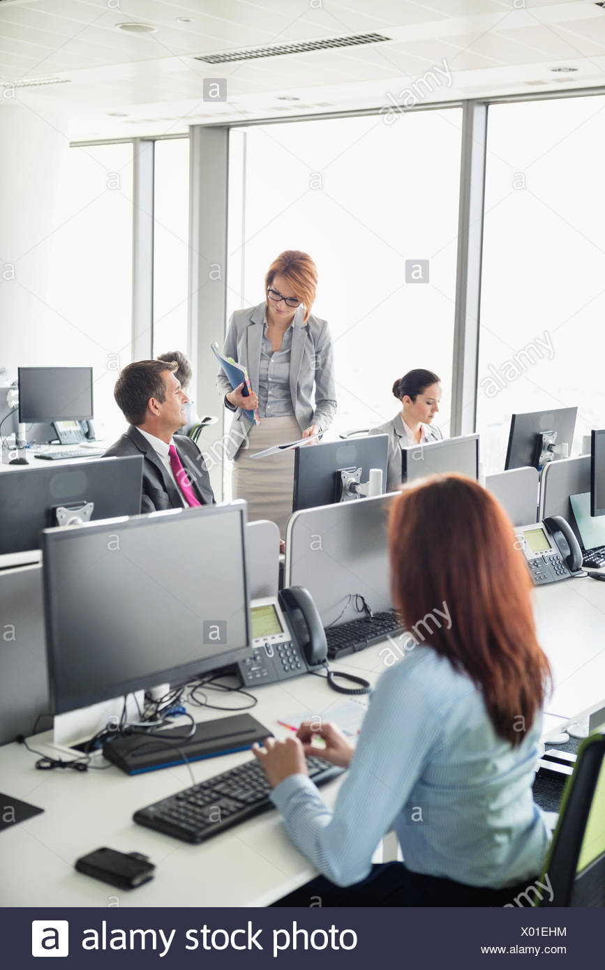 Business people working in an open plan office - Stock Image