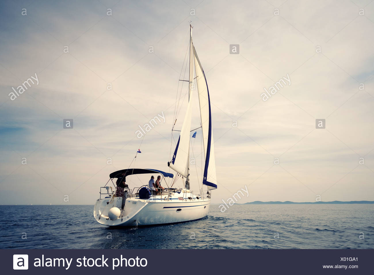 Rear view of a sailing yacht on the sea, no wind Stock Photo